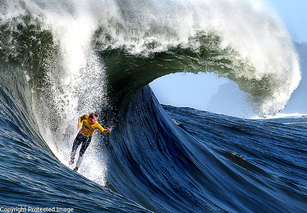A huge barrel forms behind surfer Russell Smith, of Santa Cruz, California  as he challenges a Mavericks monster during the annual Mavericks Surf Contest.  The contest takes place in a legendary break in the Pacific Ocean one-half mile off the coast of Half Moon Bay, California . <br /> Photo by Shmuel Thaler <br /> shmuel_thaler@yahoo.com www.shmuelthaler.com