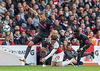 Football - 2018 / 2019 Premier League - Arsenal vs. Everton<br /> <br /> Richarlison (Everton FC ) and Idrissa Gueye (Everton FC ) combine to bring down Mesut Ozil (Arsenal FC) at The Emirates.<br /> <br /> COLORSPORT/DANIEL BEARHAM