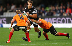 Andre Esterhuizen of the sharks is tackled by Fred Zeilinga of the Cheetahs during the Currie Cup premier division match between the The Sharks and The Cheetahs held at King's Park, Durban, South Africa on the 10th September 2016<br /> <br /> Photo by:   Anesh Debiky / Real Time Images