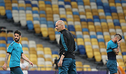 May 25, 2018 - Kiev, Ukraine - Real Madrid head coach Zinedine Zidane, in the center, during the team's training at the Olympic Stadium in Kiev. Ukraine, Friday, May 25, 2018 Tomorrow will be the final match of the Champions League between Real Madrid and Liverpool at the Olympic Stadium in Kiev. (Credit Image: © Danil Shamkin/NurPhoto via ZUMA Press)