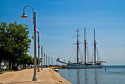 The three masted schooner Empire Sandy takes on passengers for a sail on Lake Ontario