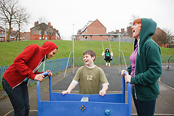 Teenagers in playground. Cleared for Mental Health Issues.