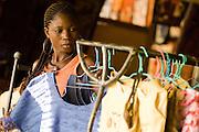 A vendor hangs clothes in her shop at the Village Artisanal de Ouagadougou, a cooperative that employs dozens of artisans who work in different mediums, in Ouagadougou, Burkina Faso, on Monday November 3, 2008.