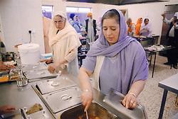 Asian women preparing food for the Baisakhi festival,