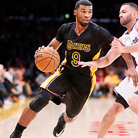 31 October 2014: Los Angeles Lakers guard Ronnie Price (9) drives past Los Angeles Clippers guard Jordan Farmar (1) during the Los Angeles Clippers 118-111 victory over the Los Angeles Lakers, at the Staples Center, Los Angeles, California, USA.