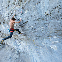 Jonathan Siegrist sending Prime Time, 5.14c at Acephale, Canmore, Alberta