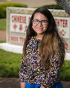 Gissell Montoya poses for a photograph at the Chinese Community Center, July 2, 2014.