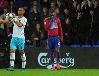 Football - 2016 / 2017 Premier League - Crystal Palace vs. West Ham United<br /> <br /> Christian Benteke of Palace bits his shirt after missing his first half Penalty as Winston Reid celebrates at Selhurst Park.<br /> <br /> COLORSPORT/ANDREW COWIE