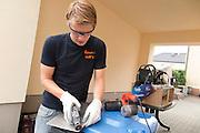 Mats is bezig met een van de laatste aanpassingen aan de VeloX IV. Het Human Power Team Delft en Amsterdam (HPT), dat bestaat uit studenten van de TU Delft en de VU Amsterdam, is in Senftenberg voor een poging het uurrecord te verbreken op de Dekrabaan met de VeloX4. In september wil het HPT daarna een poging doen het wereldrecord snelfietsen te verbreken, dat nu op 133 km/h staat tijdens de World Human Powered Speed Challenge.<br /> <br /> The Human Power Team Delft and Amsterdam, consisting of students of the TU Delft and the VU Amsterdam, is in Senftenberg (Germany) for the attempt to set a new hour record on a bicycle with the special recumbent bike VeloX4. They also wants to set a new world record cycling in September at the World Human Powered Speed Challenge. The current speed record is 133 km/h.