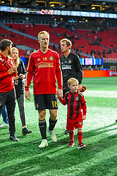 October 21, 2018 - Atlanta, GA, U.S. - ATLANTA, GA - OCTOBER 21: Atlanta United defender Jeff Larentowicz (18) with his son after the MLS game between the Atlanta United and the Chicago Fire on October 21, 2018 at the Mercedes-Benz Stadium in Atlanta, GA. Atlanta United FC secured a place in next year's CONCACAF Champions League with a 2-1 victory against the visiting Chicago Fire. (Photo by John Adams/Icon Sportswire) (Credit Image: © John Adams/Icon SMI via ZUMA Press)