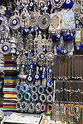 Blue Hamsa Turkish Evil Eye beads pendants and trinkets in The Grand Bazaar, Kapalicarsi, great market, Beyazi, Istanbul, Turkey
