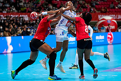 08-12-2019 JAP: Angola - France, Kumamoto<br /> First round President's Cup match Angola - France (17-28) at 24th IHF Women's Handball World Championship. / Estelle Nze Minko #27 of France, Albertina Kassoma #10 of Angola, Helena Paulo #8 of Angola