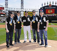 CHICAGO - APRIL 5:  Chicago Blackhawk Olympic medal winners pose with John Danks #50 of the Chicago White Sox after throwing the ceremonial first pitch on April 5, 2010 at U.S. Cellular Field in Chicago, Illinois.  Pictured are left t right; Duncan Keith, Brent Seabrook, Danks, Jonathan Toews and Patrick Kane.  The White Sox defeated the Indians 6-0.  (Photo by Ron Vesely)
