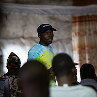 Bahati Kituli speaks to an audience in a church in Mukuru Kwa Njenga, Nairobi, Kenya. Bahati is a mentor in issues around sexual health and reproductive rights, gender-based violence and HIV.<br /> <br /> ACT Alliance member LWR/IMA supports the programme that Bahati works on.