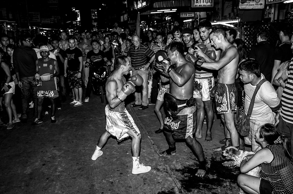 Spectators watch a demonstration of Muay Thai, sometimes referred to as Thai boxing, on Khao San Road in Bangkok, Thailand (November 19, 2011)