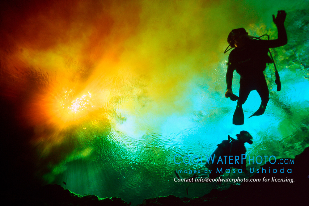 scuba diver swims at intersection of blackish water from Santa Fe River and clear water from Devils Ear Spring, Ginnie Springs, High Springs, Florida, MR