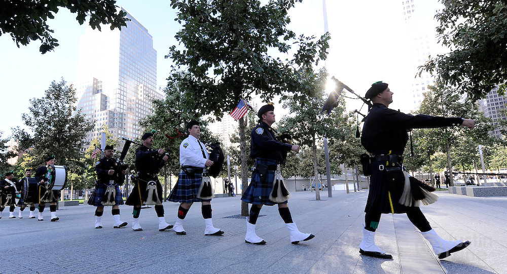 A line of bagpipers walk towards the stage past the North Pool of the 9/11 Memorial during tenth anniversary ceremonies at the site of the World Trade Center September 11, 2011, in New York. POOL/Justin Lane/EPA