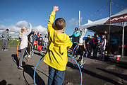 Colton Alford enters a hula hoop competition at the AARP Block Party at the Albuquerque International Balloon Fiesta in Albuquerque New Mexico USA on Oct. 8th, 2018.