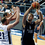 Anadolu Efes's Semih Erden (R) during their Turkish Basketball league derby match Fenerbahce Ulker between Anadolu Efes at the Ulker Sports Arena in Istanbul, Turkey, Monday, April 29, 2013. Photo by Aykut AKICI/TURKPIX