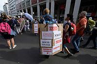 """29 AUG 2020, BERLIN/GERMANY:<br /> Demonstrant mit Schild"""" Fuck korrupe Politiker NWO Hochfinanz Gates Freimauer Skull&Bones sat...anisten"""", Demonstration gegen die Einschraenkungen in der Corona-Pandemie durch die Initiative """"Querdenken 711"""" aus Stuttgart unter dem Motto """"invites Europa - Fest für Freiheit und Frieden"""", Friedrichstrasse<br /> IMAGE: 20200829-01-015<br /> KEYWORDS: Demo, Protest, Demosntranten, Protester, COVID-19, Corona-Demo"""
