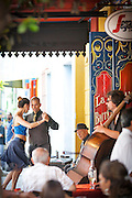 Couple dancing outside bar, La Boca, Buenos Aires, Argentina, South America