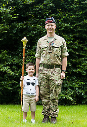 The Princess Royal, Princess Anne attended the final rehearsal of the Royal Edinburgh Military Tattoo at Redford Barracks in Edinburgh.<br /> <br /> Pictured: 3 year old Lucais James Galliano and Officer Cadet Drum Major Richard Tidy