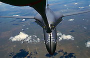A B-1 bomber takes on fuel from an airborne KC-130 tanker over Eastern Colorado.