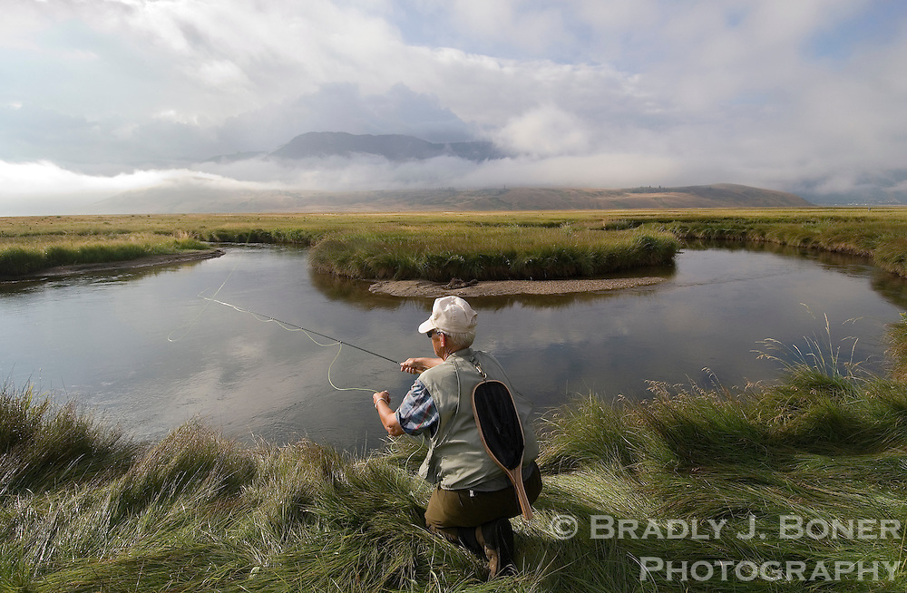 Mike Simonsen of Longmont, Colo., casts for cutthroat trout on Flat Creek, National Elk Refuge, Wyo.