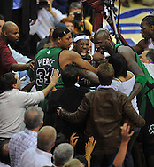 """Cleveland's LeBron James get tangles with Boston's Kevin Garnett and Paul Pierce. The play ended up spilling into the floor seats causing LeBron's mom, Gloria James, to get involved in the play. LeBron yelled for her to, """"Sit down!"""""""
