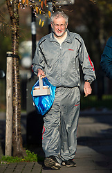 **FILE PICTURE - Monday December 21 marks 100 days since Jeremy Corbyn became leader of the Labour Party** © Licensed to London News Pictures. 28/11/2015. London, UK. Labour Party leader JEREMY CORBYN  carrying coffee and newspapers while returning to his home in Islington, north London this morning (Sat). Jeremy Corbyn has come under pressure from his own party over a potential vote on UK military involvement in Syria. Photo credit: Ben Cawthra/LNP