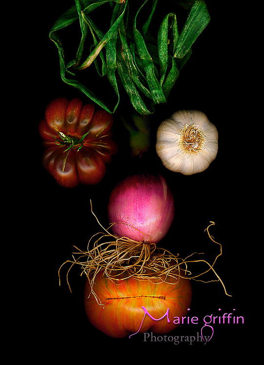 """Fresh produce-Heirloom tomatoes pictured as left eye and mouth, red onion as nose, mustache and hair, and garlic as right eye were scaned on July 13, 2007.  A flatbed scanner is used to create a """"scannergram"""" coined from the term """"Photogram,"""" which is a photo made on light scensitive material in the darkroom. This image is the art used for The Rocky food section on the peak month for Colo. produce.   Photo by: Marie Griffin Dennis"""