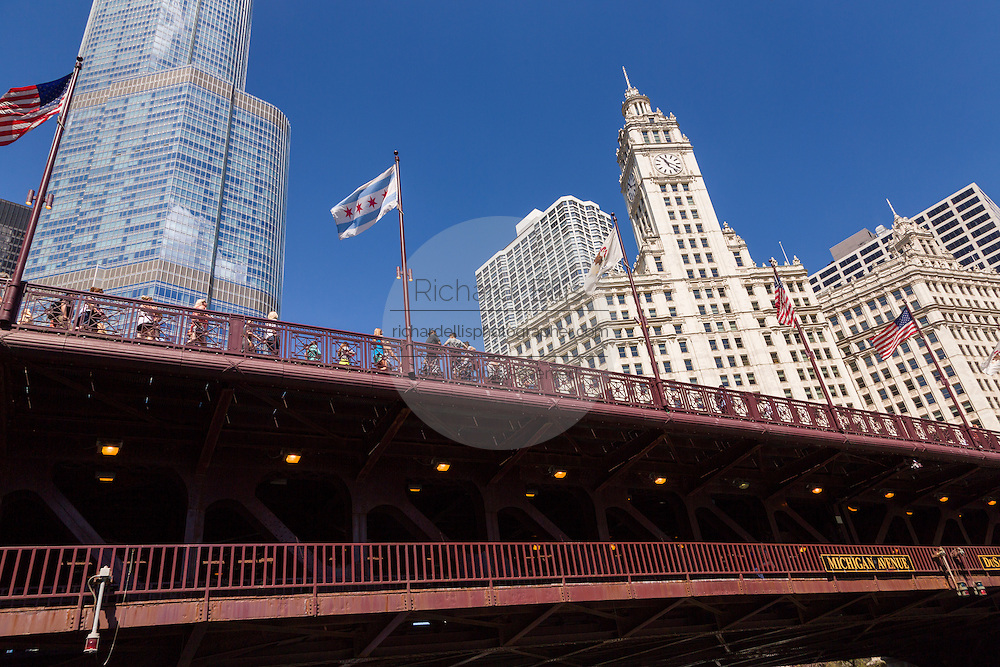 Wrigley Building and Trump Tower with the DuSable Bridge viewed from Riverwalk on a summers day in Chicago, Illinois, USA