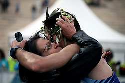November 12, 2017 - Athens, Attica, Greece - A mother hugs her son at the finish line at the Panathenaic stadium offering him an olive wreath at the 35th Athens Classic Marathon in Athens, Greece, November 12, 2017. (Credit Image: © Giorgos Georgiou/NurPhoto via ZUMA Press)