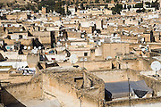 Modern television satellite dishes dot the roofs of the medieval city of Fes El-Bali, Morocco.