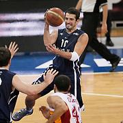 Anadolu Efes's Kerem TUNCERI (B) during their BEKO Basketball League derby match Galatasaray between Anadolu Efes at the Abdi Ipekci Arena in Istanbul at Turkey on Sunday, November 13 2011. Photo by TURKPIX