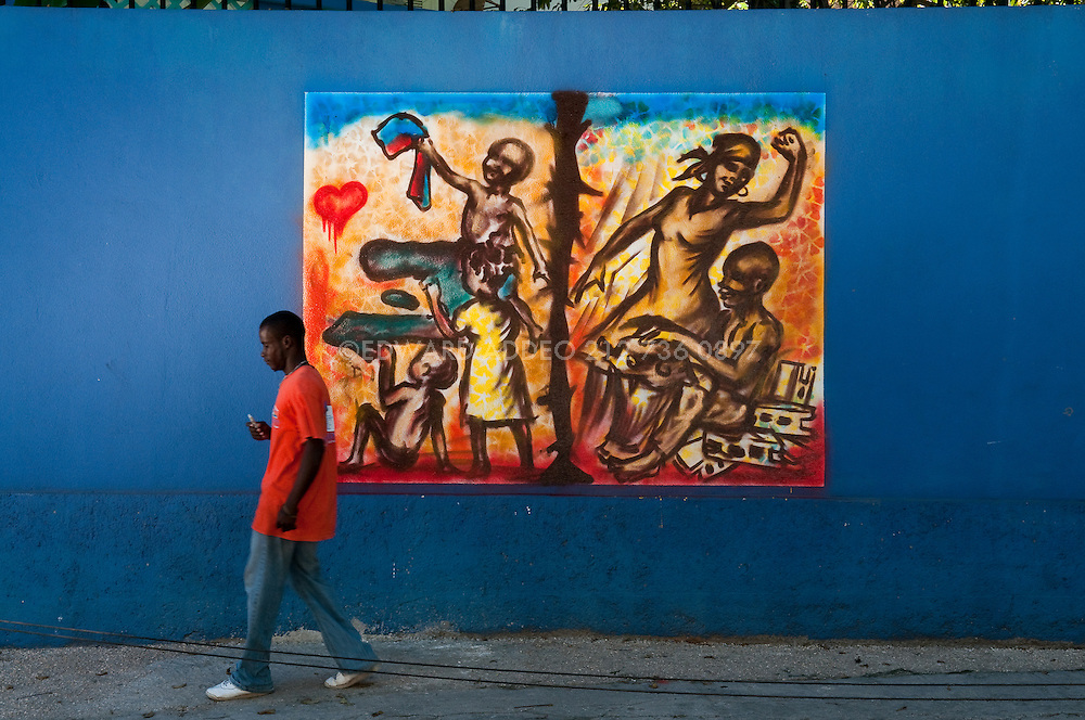 "In Port au Prince graffiti artist Jerry Moise Rosembert is the only graffiti artist of Haiti. You can find his social-political images all over the walls of the capital. ""Haiti's potential lies in its spirited people and the hands with which they rebuild their country. The innate Haitian ability to create something valuable, vibrant, and beautiful from nothing is their gift to the world"" SB"