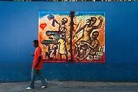 """In Port au Prince graffiti artist Jerry Moise Rosembert is the only graffiti artist of Haiti. You can find his social-political images all over the walls of the capital. """"Haiti's potential lies in its spirited people and the hands with which they rebuild their country. The innate Haitian ability to create something valuable, vibrant, and beautiful from nothing is their gift to the world"""" SB"""