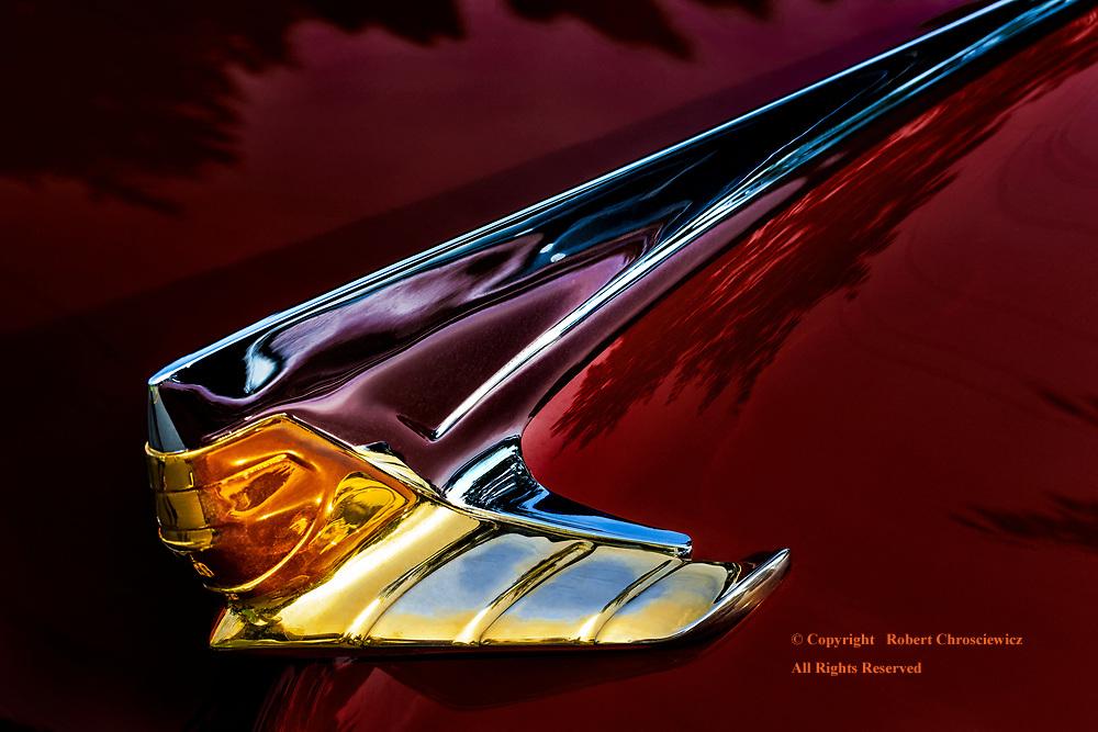 Lincoln Deco: A stylish hood ornament of the art deco fashion on a 1955 Ford Lincoln, Aldergrove British Columbia Canada.