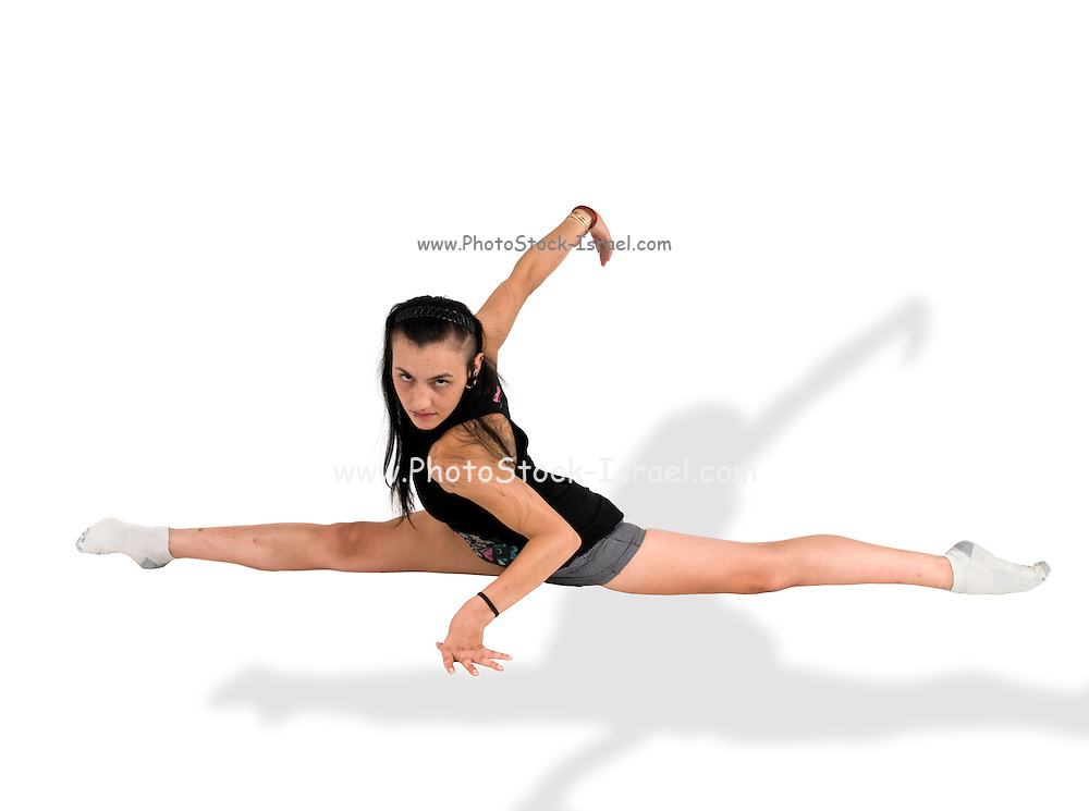young female gymnast does the splits
