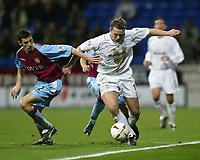 Photo. Aidan Ellis.<br />Bolton Wanderers v Aston Villa.<br />Carling Cup Semi Final 1st Leg.<br />21/01/2004<br />Bolton's Kevin Davis and Villa's Mark Delaney battle for possesion