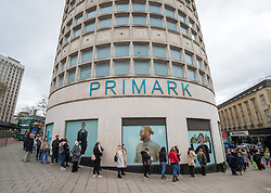 © Licensed to London News Pictures;12/04/2021; Bristol, UK. People queue round the block at Primark in Broadmead as lockdown restrictions are eased to allow non-essential shopping on Monday 12 April during the Covid-19 coronavirus pandemic in England. Photo credit: Simon Chapman/LNP.