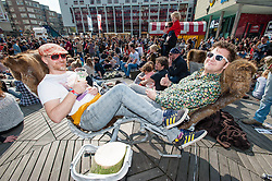 © Licensed to London News Pictures. 05/04/2014. Rotterdam, Netherlands.   Festival goers relax in the sun alongside music venues at Motel Mozaïque Festival.   Motel Mozaïque  is an annual music/arts festival, held annually in Rotterdam, Netherlands.  Photo credit : Richard Isaac/LNP