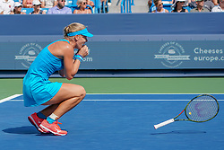 August 19, 2018 - Mason, Ohio, USA - Kiki Bertens (NED) slams her racket after an ace to win Sunday's final round of the Western and Southern Open at the Lindner Family Tennis Center, Mason, Oh. (Credit Image: © Scott Stuart via ZUMA Wire)