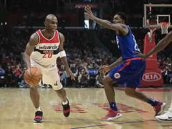 December 9, 2017 - Los Angeles, California, United States of America - Jodie Meeks #20 of the Washington Wizards dribbles against Lou Williams #23 of the Los Angeles Clippers during their NBA game on Saturday December 9, 2017 at the Staples Center in Los Angeles, California. Clippers defeat Wizards, 113-112. JAVIER ROJAS/PI (Credit Image: © Prensa Internacional via ZUMA Wire)