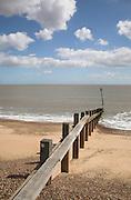 Wooden groyne and differing beach levels indicating longshore drift, coastal defences, Felixstowe, Suffolk, England