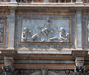 Relief at the base of the campanile in st marks square, Venice, Italy. The relief by Jacopo Sansovino created in 1540, depicts allegorical figures. Shown here is the justice symbol.