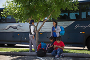 Orfa, a Honduran migrant seeking asylum, and her children (from L) Bayron, Rachel and Carolina wait for her niece to pick them up after getting off a Greyhound bus in Portales, New Mexico, U.S., May 16, 2018.