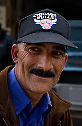 Hamid Mohammed, 38, a shop owner, is seen in the Sabra and Shatila neighborhood in Beirut, Lebanon, March 17, 2006. On Sept. 16, 1982, what is considered one of the worst atrocities of the civil war happened in this refugee camp. Militants from the Lebanese Forces, with help from the Israeli military, closed off the Palestinian quarters of the Sabra and Shatila refugee camps and killed up to 2,000 Palestinian civilians over three days. Today there are 12 official refugee camps scattered across Lebanon housing some 400,000 Palestinian refugees.