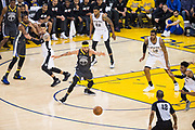 Golden State Warriors center JaVale McGee (1) chases down a loose ball against the San Antonio Spurs during Game 2 of the Western Conference Quarterfinals at Oracle Arena in Oakland, Calif., on April 16, 2018. (Stan Olszewski/Special to S.F. Examiner)