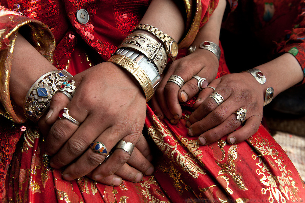 """Women often wear several watches. """"I was given a watch for my wedding - it broke. Then my mother in law gave me a new one, so now I have 2 on my wrist"""" says Rosman's wife. Khan's summer camp..."""